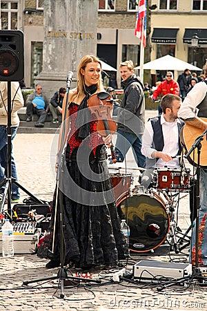 Street musician in Bruges (Belgium) Editorial Stock Photo