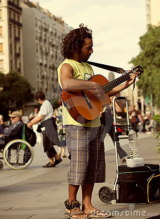 Street musician playing guitar Editorial Stock Image