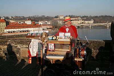 Street organ gringer on Charles Bridge. Prague Editorial Stock Image