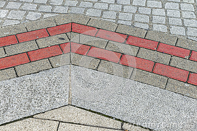 Street pavement pattern with grey and pink stones