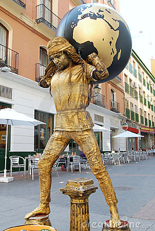 Street performer (busker) in Spain with globe Editorial Stock Photo