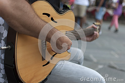 Street performer with guitar