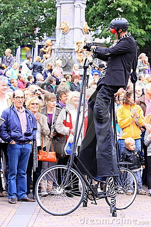 Street performer with special bike Editorial Stock Image