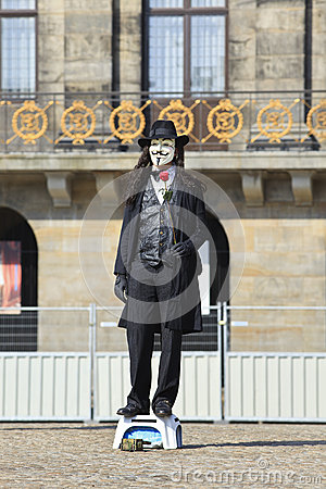 Street performer with Vendetta mask Editorial Stock Photo