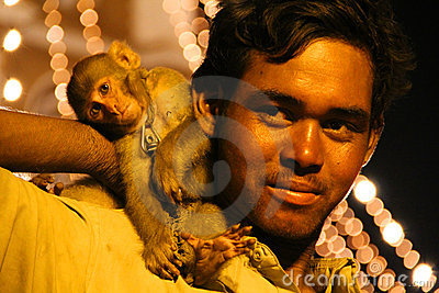 Street Performing Juggler with his Monkey Editorial Photography