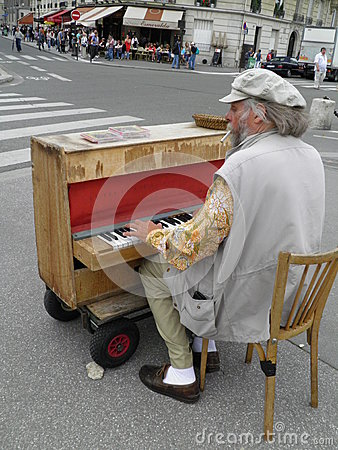 Street piano player in Paris Editorial Stock Photo