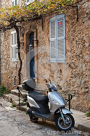 Street in Saint Tropez with moped