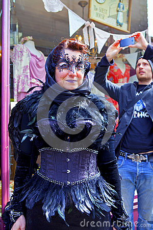 Street scene with masked Goth woman being photographed in Whitby. Editorial Stock Image