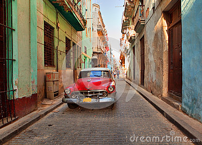 Street scene with an old rusty american car Editorial Stock Image