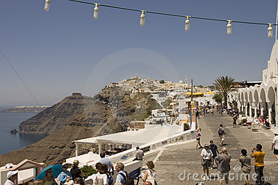 Street scene with tourists in Fira, Santorini Editorial Stock Photo