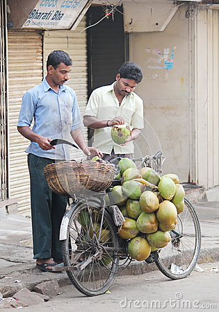 Street seller selling coconuts, India Editorial Photography