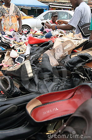 Street seller of shoes on an African market, Ghana
