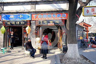 Street and shops inside a Beijing hutong. Editorial Photography