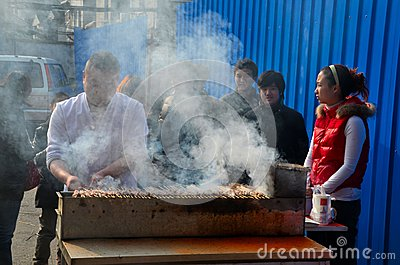 Street side food vendor grills meat skewers Shanghai China Editorial Photography