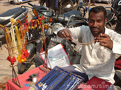 A street vendor offers his goods Editorial Stock Photo