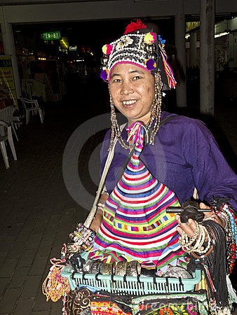 Street vendor selling hats and jewelry Editorial Stock Photo