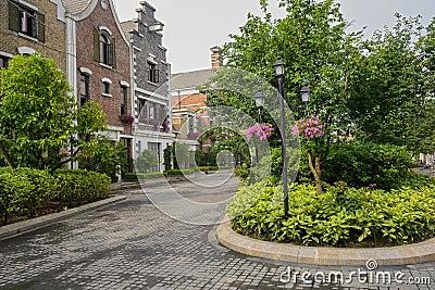 Streetlamp before European-style buildings in spring morning