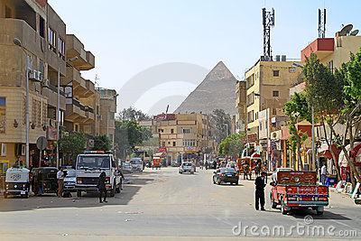 Streets of Cairo with Great pyramids of Giza Editorial Photo