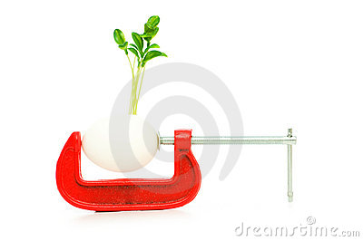 Strength concept with egg and clamp
