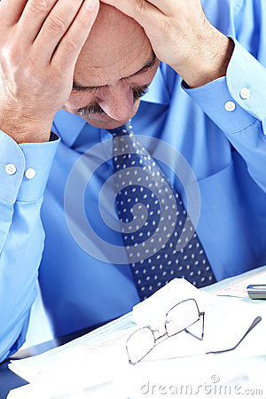 Stress. Businessman in the office