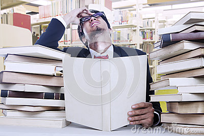 Stress businessman and stack of books