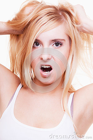Free Stress. Young Woman Frustrated Pulling Her Hair On White Royalty Free Stock Photography - 36026257