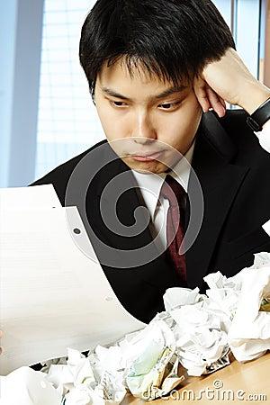 Free Stressed Asian Businessman Royalty Free Stock Photos - 5491118