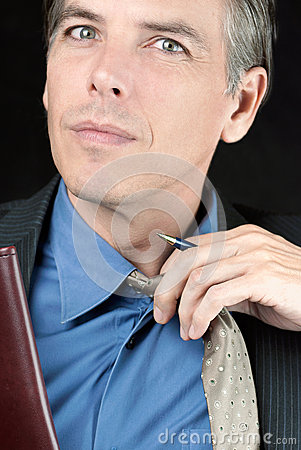 Stressed Businessman Adjusts Tie