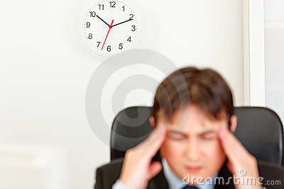 Stressed businessman aware of approaching deadline