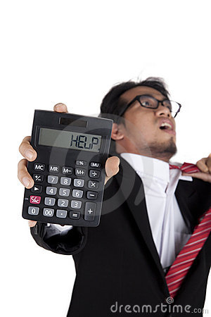 Stressed businessman holding a calculator