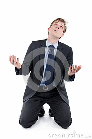 Stressed businessman on knees