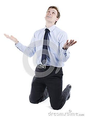 Stressed businessman on knees