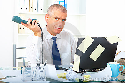 Stressed businessman sitting at desk