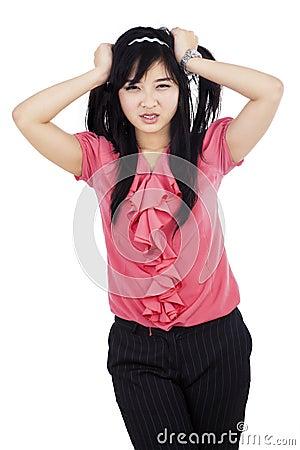 Stressed businesswoman grabbing her hair