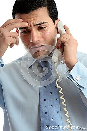Stressed  depressed man businessman on phone