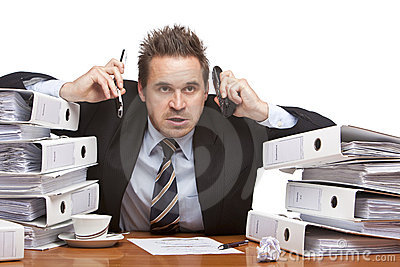 Stressed frustrated business man with telephones