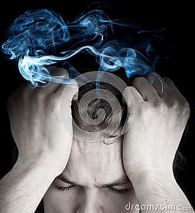 Stressed man with smoking head