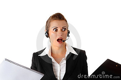 Stressed modern business woman with headset