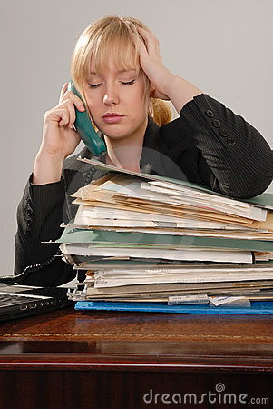 Stressed office executive on phone
