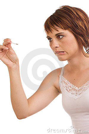 Stressed out Caucasian female holding a fever pen