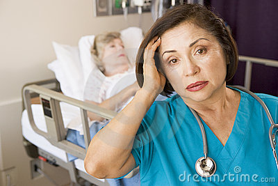 Stressed Out Doctor In Patients Room