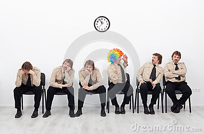 Stressed people waiting for a job interview