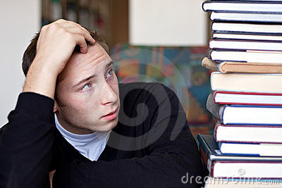 Stressed Student Looks At Books