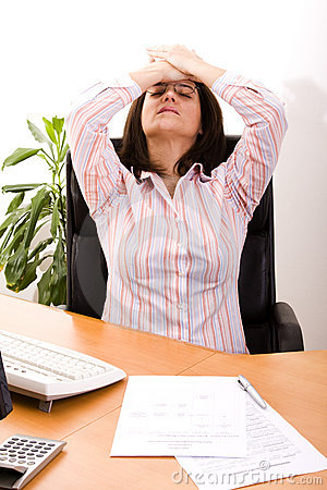 Free Stressed With Her Work Stock Image - 8456891