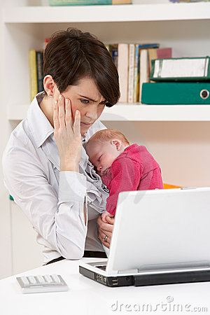 Stressed Woman With Baby Working From Home