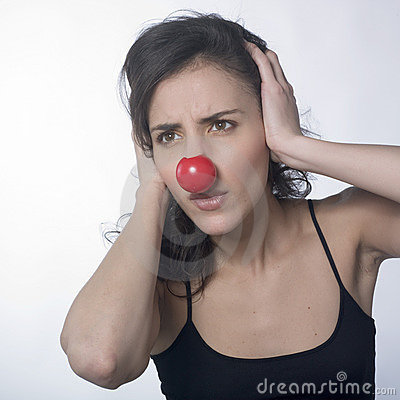 Stressed woman covering ears