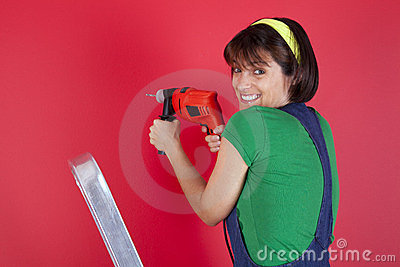 Stressed woman holding a electric drill