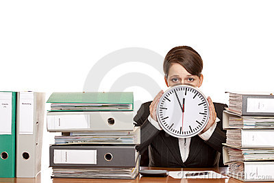 Stressed Woman i office with time pressure
