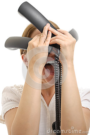 Stressed woman with phone receivers on white