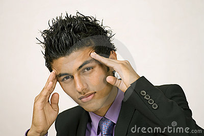 Stressed young man holding head